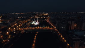 Aerial view of night Valencia with fun fair in park stock video footage