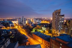 Aerial view of night Voronezh downtown. Voronezh cityscape at blue hour. Urban and traffic lights, houses Stock Photos
