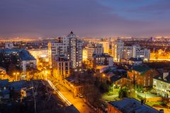 Aerial view of night Voronezh downtown. Voronezh cityscape at blue hour. Urban and traffic lights, houses Stock Image