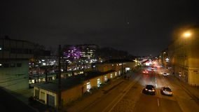 Multilane street at night in Vienna. Aerial view of nightly traffic on the Waehringer Guertel near Michelbeuern and the Vienna General Hospital AKH. Pan shot stock video footage