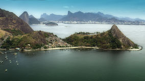 Aerial View of Niteroi Coastline with distant Sugar Loaf mountain Royalty Free Stock Images