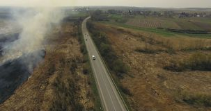 Aerial view of non-urban landscape, road and fields in 4K.  stock footage