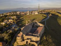 Aerial view of the Norman Swabian castle, Vibo Valentia, Calabria, Italy. Overview of the city seen from the sky, houses and roofs royalty free stock images