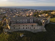 Aerial view of the Norman Swabian castle, Vibo Valentia, Calabria, Italy. Overview of the city seen from the sky, houses and roofs royalty free stock image