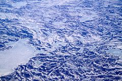 An aerial view of North Atlantic Ocean covered with mix of ice and snow. stock image