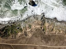 Aerial View of Northern California Shoreline. The Pacific Ocean washes against the rocky coastline in Sonoma, California. The famous Highway 1 runs along this Royalty Free Stock Photography