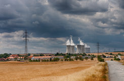 Aerial view of nuclear power station with cooling towers against Royalty Free Stock Photography