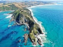 Aerial view of nugget point shore with lighthouse royalty free stock image