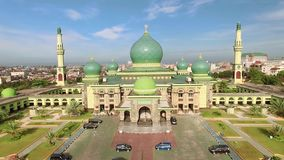 Aerial view of An-Nur Great Mosque in Pekanbaru city, Sumatra, Indonesia. Aerial view of An-Nur Great Mosque in Pekanbaru city. Shot with drone on sunny day stock footage