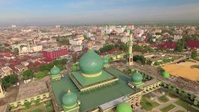 Aerial view of An-Nur Great Mosque in Pekanbaru city, Sumatra, Indonesia. Aerial view of An-Nur Great Mosque in Pekanbaru city. Shot with drone on sunny day stock video