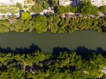 Aerial view o Marapendi canal in Barra da tijuca on a summer day. Green vegetation can be seen on both sides, as well as. Houses royalty free stock image