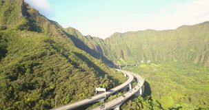 Aerial View of the Oahu Green Mountains. Gorgeous aerial view of the Oahu green mountains view by the Ho`omaluhia Botanical Garden in Kaneohe. Mountains with stock video footage