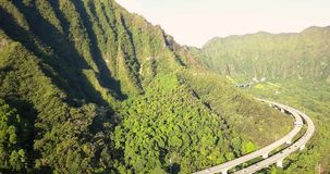 Aerial View of the Oahu Green Mountains. Gorgeous aerial view of the Oahu green mountains view by the Ho`omaluhia Botanical Garden in Kaneohe. Mountains with stock video