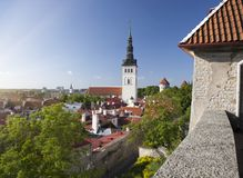 Aerial view on observation deck of Old city roofs and St. Nicholas Church Niguliste . Tallinn. Estonia Stock Image