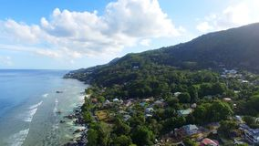 Aerial view of ocean and houses on the beach on tropical island, Seychelles 3. Drone shot of Beau Vallon Beach, ocean and houses on the beach on tropical island stock footage