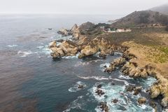 Aerial View of Ocean and Rocky Coastline in California royalty free stock photo