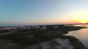 Aerial view of ocean and sound at sunset. Video of aerial view of ocean and sound at sunset stock video