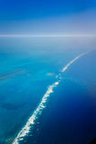 Aerial view of ocean waves breaking over the barrier reef Stock Photos
