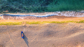 Aerial view of ocean waves and sand on beach Stock Photography