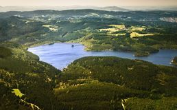 An aerial view od a dam and mountains Royalty Free Stock Images