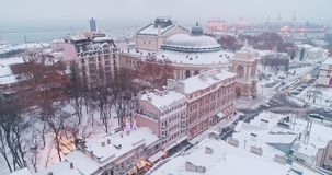 Aerial view on Odessa city center with sea port lights at winter stock video footage