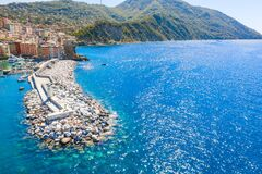 Free Aerial View Of A Breakwater And A Lighthouse In Ligurian Sea With Mountain On The Background. Camogli Near Genoa, Italy Stock Image - 172280351