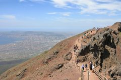 Aerial View Of City And Gulf Of Naples Napoli And Tourists On The Edge Of Volcano Cone Of Mount Vesuvius Monte Vesuvio, Campan Stock Photos