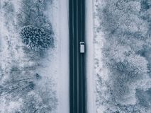 Free Aerial View Of Country Road Going Through The Beautiful Snow Covered Landscape Royalty Free Stock Images - 134840209