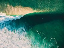 Free Aerial View Of Crashing Wave In Ocean With Surfers And Sunset Light. Wave Crashing On Reef. Top View Royalty Free Stock Photos - 127996858