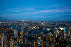 Free Aerial View Of East Side Of Manhattan And Brooklyn Bridges Showing Lights In The Variety Of Shapes And Patterns Of Buildings On Sh Stock Image - 68880181