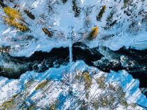 Free Aerial View Of Fast River With Suspension Foot Bridge. Snow Winter Forest In Finland Royalty Free Stock Photo - 170487445
