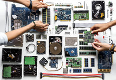 Free Aerial View Of Hands With Computer Electronics Parts On White Background Royalty Free Stock Image - 99196716