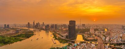 Free Aerial View Of Ho Chi Minh City, Vietnam. Beauty Skyscrapers Along River Light Smooth Down Urban Development. Dramatic Lighting Stock Images - 215497134