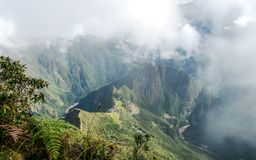 Free Aerial View Of Machu Picchu Inca Citadel In The Clouds, Located On A Mountain Ridge Above The Sacred Valley Royalty Free Stock Images - 154130039
