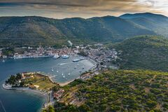 Free Aerial View Of Marina Vis At Sunset, Croatia, A Lot Of Chaotically Standing Boats In A Bay, Roofs Of Orange Color Stock Image - 178390331