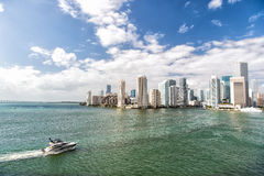 Aerial View Of Miami Skyscrapers With Blue Cloudy Sky, Boat Sail Royalty Free Stock Photos