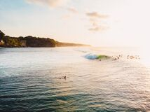 Free Aerial View Of Ocean With Waves, Surfers And Sunset. Drone View In Bali Stock Photos - 190675863