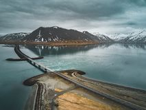 Free Aerial View Of Road 1 In Iceland With Bridge Over The Sea In Snaefellsnes Peninsula With Clouds, Water And Mountain In Royalty Free Stock Photos - 121728588