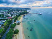 Free Aerial View Of Sorrento Long Pier, Moored Passenger Ferry And Suburban Houses At Dawn. Stock Images - 91002654