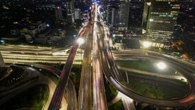 Free Aerial View Of The City Traffics At The Jakarta At Night. Vehicles Are Moving On The Road Between Buildings. Jakarta, Indonesia, Stock Images - 217733254