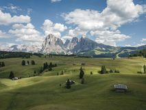 Free Aerial View Of The Landscapes In Alpe Di Siusi In Summer, Natural Landscapes In Dolomites With Sassolungo Or Langkofel Mountain Gr Stock Photo - 165236730