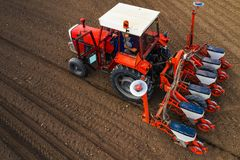Free Aerial View Of Tractor With Mounted Seeder Performing Direct Seeding Royalty Free Stock Photography - 145644217