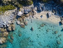 Free Aerial View Of Tropea Beach, Crystal Clear Water And Rocks That Appear On The Beach. Calabria, Italy. Swimmers, Bathers Floating Royalty Free Stock Image - 163637666