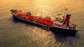 Aerial view oil and gas chemical tanker in open sea at sunset, Refinery Industry cargo ship.  stock images