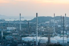 Aerial view of Oil and gas industry - refinery at sunset - factory - petrochemical plant, Shot from drone of Oil refinery and stock photography