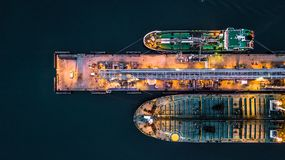 Aerial view of oil tanker ship at the port, Aerial view oil term. Inal is industrial facility for storage of oil and petrochemical products ready for transport Royalty Free Stock Photos