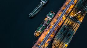 Aerial view of oil tanker ship at the port, Aerial view oil term. Inal is industrial facility for storage of oil and petrochemical products ready for transport Royalty Free Stock Image