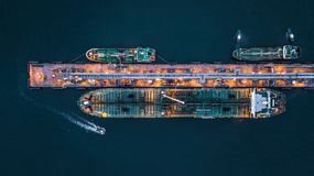 Aerial view of oil tanker ship at the port, Aerial view oil term. Inal is industrial facility for storage of oil and petrochemical products ready for transport Stock Images