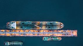 Aerial view of oil tanker ship at the port, Aerial view oil term. Inal is industrial facility for storage of oil and petrochemical products ready for transport Stock Image