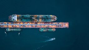 Aerial view of oil tanker ship at the port, Aerial view oil term. Inal is industrial facility for storage of oil and petrochemical products ready for transport Royalty Free Stock Photography
